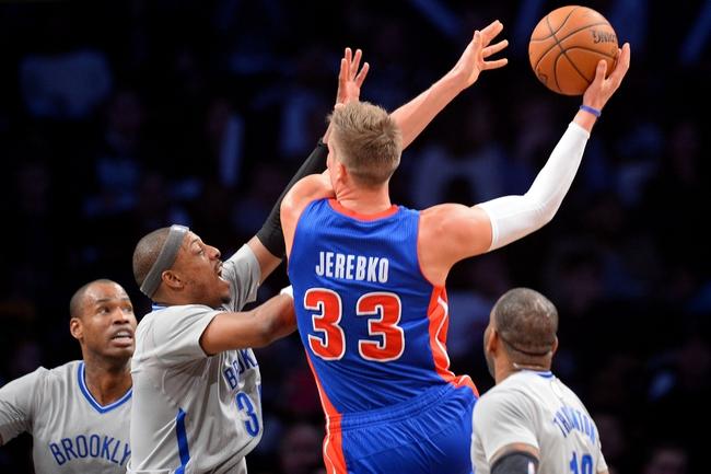 Apr 4, 2014; Brooklyn, NY, USA; Brooklyn Nets forward Paul Pierce (34) guards Detroit Pistons forward Jonas Jerebko (33) during the second half at Barclays Center. The Nets won 116-104. Mandatory Credit: Joe Camporeale-USA TODAY Sports