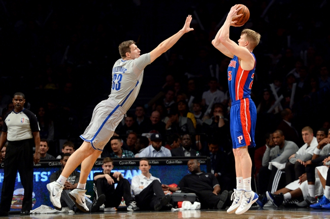 Apr 4, 2014; Brooklyn, NY, USA; Detroit Pistons forward Kyle Singler (25) shoots over Brooklyn Nets forward Mirza Teletovic (33) during the second half at Barclays Center. The Nets won 116-104. Mandatory Credit: Joe Camporeale-USA TODAY Sports