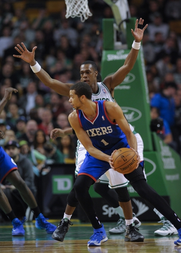 Apr 4, 2014; Boston, MA, USA; Philadelphia 76ers guard Michael Carter-Williams (1) controls the ball while being guarded by Boston Celtics guard Rajon Rondo (9) during the second half at TD Garden. Mandatory Credit: Bob DeChiara-USA TODAY Sports