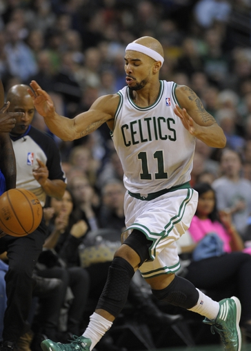 Apr 4, 2014; Boston, MA, USA; Boston Celtics guard Jerryd Bayless (11) runs after a loose ball during the second half against the Philadelphia 76ers at TD Garden. Mandatory Credit: Bob DeChiara-USA TODAY Sports