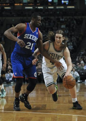 Apr 4, 2014; Boston, MA, USA; Philadelphia 76ers forward Thaddeus Young (21) guards Boston Celtics center Kelly Olynyk (41) during the second half at TD Garden. Mandatory Credit: Bob DeChiara-USA TODAY Sports
