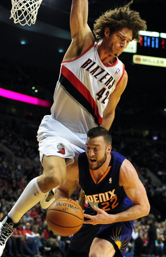 Apr 4, 2014; Portland, OR, USA;Portland Trail Blazers center Robin Lopez (42) goes up to block the shot of Phoenix Suns center Miles Plumlee (22) during the first quarter of the game at Moda Center. Mandatory Credit: Steve Dykes-USA TODAY Sports