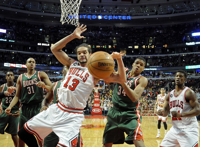 Apr 4, 2014; Chicago, IL, USA; Chicago Bulls center Joakim Noah (13) and Milwaukee Bucks guard Giannis Antetokounmpo (34) go for a loose ball during the second half at the United Center. The Chicago Bulls defeated the Milwaukee Bucks 102-90. Mandatory Credit: David Banks-USA TODAY Sports