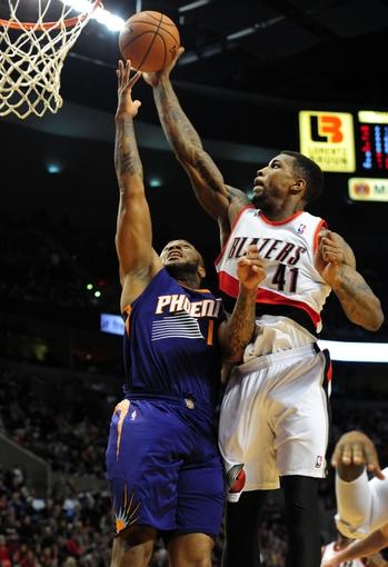 Apr 4, 2014; Portland, OR, USA; Portland Trail Blazers forward Thomas Robinson (41) blocks the shot of Phoenix Suns forward P.J. Tucker (17) during the first quarter of the game at Moda Center. Mandatory Credit: Steve Dykes-USA TODAY Sports