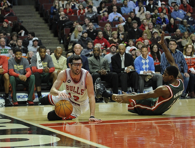 Apr 4, 2014; Chicago, IL, USA; Chicago Bulls guard Kirk Hinrich (12) is fouled by Milwaukee Bucks guard Brandon Knight (11) during the second half at the United Center. The Chicago Bulls defeated the Milwaukee Bucks 102-90. Mandatory Credit: David Banks-USA TODAY Sports