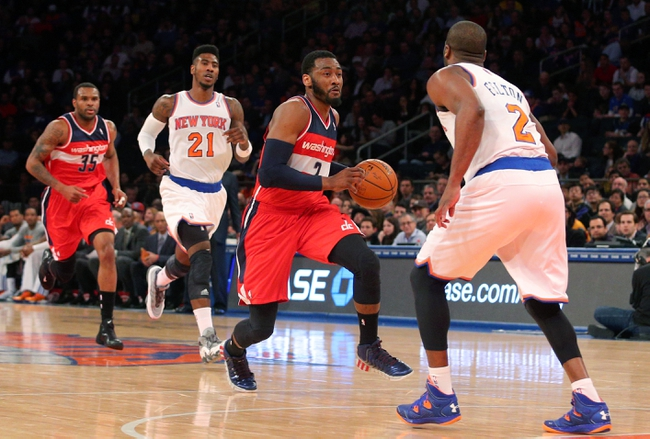 Apr 4, 2014; New York, NY, USA; Washington Wizards point guard John Wall (2) controls the ball against New York Knicks point guard Raymond Felton (2) and Knicks shooting guard Iman Shumpert (21) during the first quarter of a game at Madison Square Garden. Mandatory Credit: Brad Penner-USA TODAY Sports