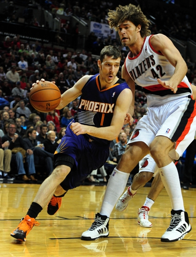 Apr 4, 2014; Portland, OR, USA; Phoenix Suns guard Goran Dragic (1) drives past Portland Trail Blazers center Robin Lopez (42) during the first quarter of the game at Moda Center. Mandatory Credit: Steve Dykes-USA TODAY Sports