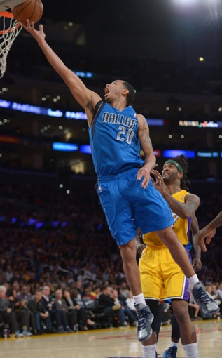 Apr 4, 2014; Los Angeles, CA, USA; Dallas Mavericks guard Devin Harris (20) shoots the ball as Los Angeles Lakers forward Jordan Hill (27) defends at Staples Center. Mandatory Credit: Kirby Lee-USA TODAY Sports