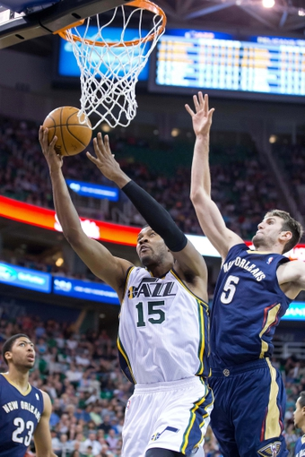Apr 4, 2014; Salt Lake City, UT, USA; Utah Jazz center Derrick Favors (15) goes to the basket in front of New Orleans Pelicans center Jeff Withey (5) during the second half at EnergySolutions Arena. The Jazz won 100-96. Mandatory Credit: Russ Isabella-USA TODAY Sports