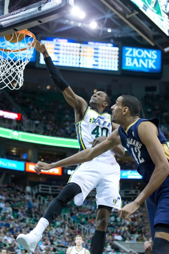Apr 4, 2014; Salt Lake City, UT, USA; Utah Jazz forward Jeremy Evans (40) dunks over New Orleans Pelicans center Alexis Ajinca (42) just after the buzzer sounded to end the third quarter at EnergySolutions Arena. The Jazz won 100-96. Mandatory Credit: Russ Isabella-USA TODAY Sports