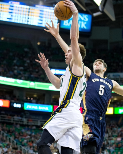 Apr 4, 2014; Salt Lake City, UT, USA; Utah Jazz guard Gordon Hayward (20) goes up for a shot in front of New Orleans Pelicans center Jeff Withey (5) during the second half at EnergySolutions Arena. The Jazz won 100-96. Mandatory Credit: Russ Isabella-USA TODAY Sports