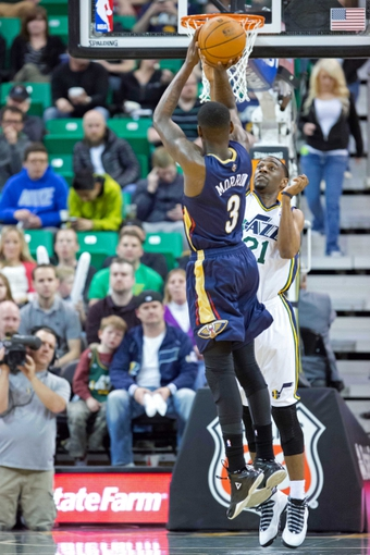 Apr 4, 2014; Salt Lake City, UT, USA; New Orleans Pelicans guard Anthony Morrow (3) shoots against Utah Jazz guard Ian Clark (21) during the second half at EnergySolutions Arena. The Jazz won 100-96. Mandatory Credit: Russ Isabella-USA TODAY Sports