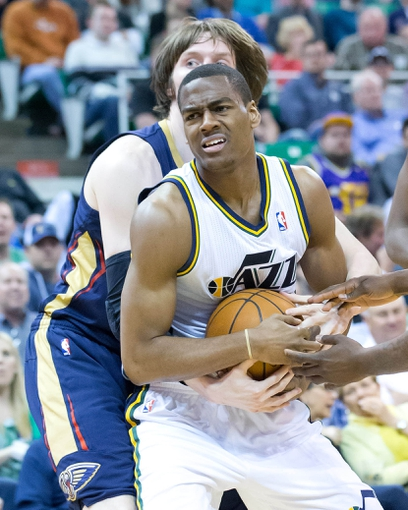 Apr 4, 2014; Salt Lake City, UT, USA; Utah Jazz guard Alec Burks (10) is fouled by New Orleans Pelicans forward Luke Babbitt (8) during the second half at EnergySolutions Arena. The Jazz won 100-96. Mandatory Credit: Russ Isabella-USA TODAY Sports