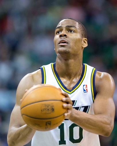 Apr 4, 2014; Salt Lake City, UT, USA; Utah Jazz guard Alec Burks (10) shoots a free throw during the second half against the New Orleans Pelicans at EnergySolutions Arena. The Jazz won 100-96. Mandatory Credit: Russ Isabella-USA TODAY Sports
