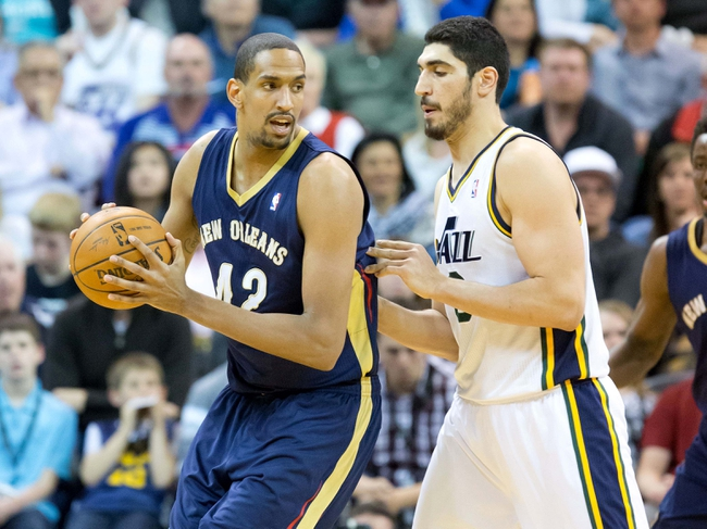 Apr 4, 2014; Salt Lake City, UT, USA; Utah Jazz center Enes Kanter (0) defends against New Orleans Pelicans center Alexis Ajinca (42) during the second half at EnergySolutions Arena. The Jazz won 100-96. Mandatory Credit: Russ Isabella-USA TODAY Sports