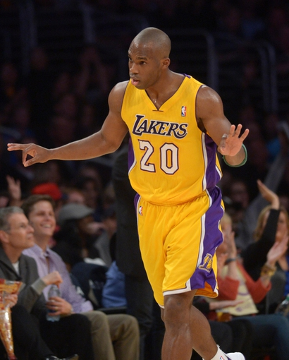 Apr 4, 2014; Los Angeles, CA, USA; Los Angeles Lakers guard Jodie Meeks (20) reacts after a 3-point basket against the Dallas Mavericks at Staples Center. Mandatory Credit: Kirby Lee-USA TODAY Sports