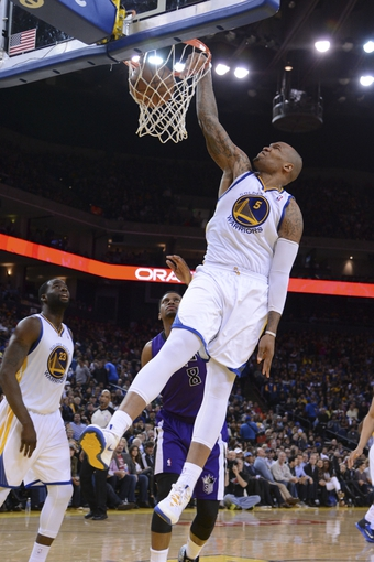 April 4, 2014; Oakland, CA, USA; Golden State Warriors forward Marreese Speights (5) dunks the ball against the Sacramento Kings during the third quarter at Oracle Arena. The Warriors defeated the Kings 102-69. Mandatory Credit: Kyle Terada-USA TODAY Sports