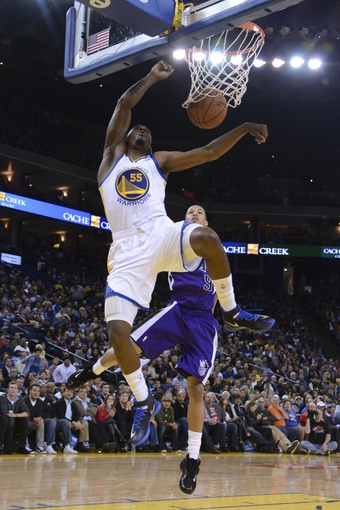 April 4, 2014; Oakland, CA, USA; Golden State Warriors guard Jordan Crawford (55) shoots against Sacramento Kings guard Jared Cunningham (9) during the third quarter at Oracle Arena. The Warriors defeated the Kings 102-69. Mandatory Credit: Kyle Terada-USA TODAY Sports