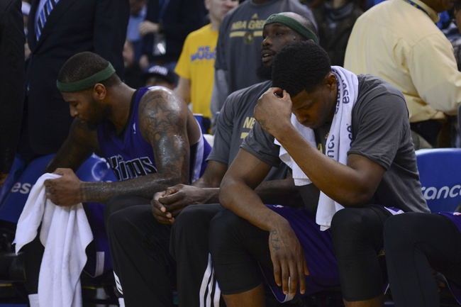 April 4, 2014; Oakland, CA, USA; Sacramento Kings center DeMarcus Cousins (15, left), forward Reggie Evans (30, center), and forward Rudy Gay (8, right) react during the fourth quarter against the Golden State Warriors at Oracle Arena. The Warriors defeated the Kings 102-69. Mandatory Credit: Kyle Terada-USA TODAY Sports