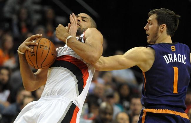 Apr 4, 2014; Portland, OR, USA; Phoenix Suns guard Goran Dragic (1) reaches in on Portland Trail Blazers forward Nicolas Batum (88) during the fourth quarter of the game at Moda Center. The Suns won the game 109-93. Mandatory Credit: Steve Dykes-USA TODAY Sports