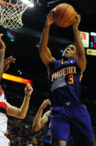 Apr 4, 2014; Portland, OR, USA; Phoenix Suns guard Ish Smith (3) grabs a rebound during the third quarter of the game against the Portland Trail Blazers at Moda Center. Mandatory Credit: Steve Dykes-USA TODAY Sports