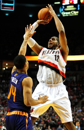 Apr 4, 2014; Portland, OR, USA; Portland Trail Blazers forward LaMarcus Aldridge (12) shoots the ball over Phoenix Suns guard Gerald Green (14) during the third quarter of the game at Moda Center. Mandatory Credit: Steve Dykes-USA TODAY Sports