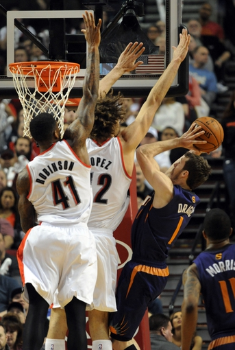 Apr 4, 2014; Portland, OR, USA; Phoenix Suns guard Goran Dragic (1) goes up for a shot on Portland Trail Blazers forward Thomas Robinson (41) and Portland Trail Blazers center Robin Lopez (42) during the third quarter of the game at Moda Center. the Suns won the game 109-93. Mandatory Credit: Steve Dykes-USA TODAY Sports
