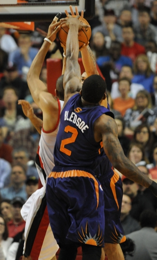Apr 4, 2014; Portland, OR, USA; Phoenix Suns guard Eric Bledsoe (2) blocks the shot of Portland Trail Blazers forward Nicolas Batum (88) from behind during the fourth quarter of the game against the Phoenix Suns at Moda Center. the Suns won the game 109-93. Mandatory Credit: Steve Dykes-USA TODAY Sports
