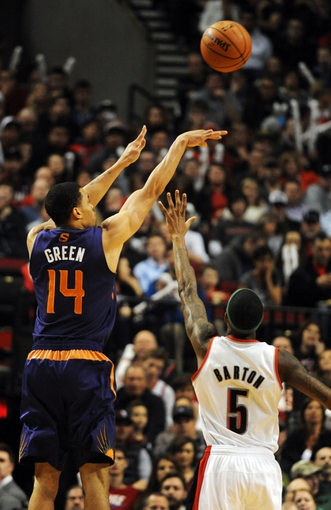 Apr 4, 2014; Portland, OR, USA; Phoenix Suns guard Gerald Green (14) hits a three point shot over Portland Trail Blazers guard Will Barton (5) during the fourth quarter of the game at Moda Center. Mandatory Credit: Steve Dykes-USA TODAY Sports