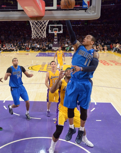 Apr 4, 2014; Los Angeles, CA, USA; Dallas Mavericks guard Monta Ellis (11) shoots the ball as Los Angeles Lakers forward Jordan Hill (27) defends at Staples Center. The Mavericks defeated the Lakers 107-95.  Mandatory Credit: Kirby Lee-USA TODAY Sports