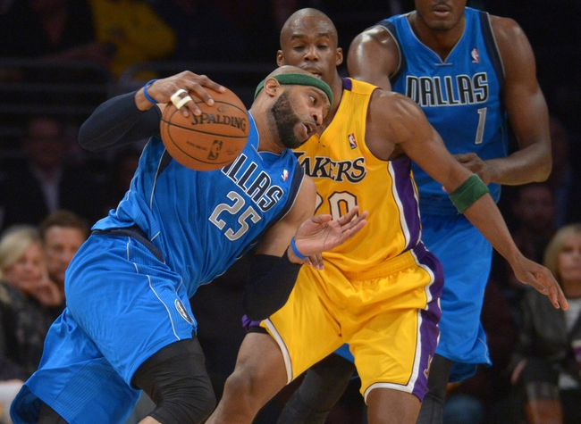 Apr 4, 2014; Los Angeles, CA, USA; Dallas Mavericks forward Vince Carter (25) is defended by Los Angeles Lakers guard Jodie Meeks (20) at Staples Center. The Mavericks defeated the Lakers 107-95.  Mandatory Credit: Kirby Lee-USA TODAY Sports