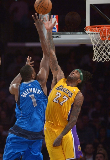 Apr 4, 2014; Los Angeles, CA, USA; Dallas Mavericks center Samuel Dalembert (1) is defended by Los Angeles Lakers forward Jordan Hill (27) at Staples Center. The Mavericks defeated the Lakers 107-95.  Mandatory Credit: Kirby Lee-USA TODAY Sports