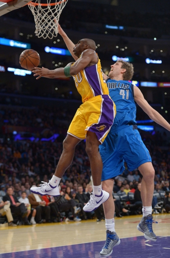 Apr 4, 2014; Los Angeles, CA, USA; Los Angeles Lakers guard Jodie Meeks (20) is defended by Dallas Mavericks forward Dirk Nowitzki (41) at Staples Center. The Mavericks defeated the Lakers 107-95.  Mandatory Credit: Kirby Lee-USA TODAY Sports
