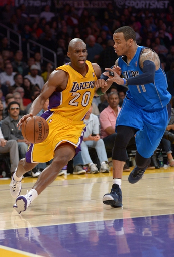 Apr 4, 2014; Los Angeles, CA, USA; Los Angeles Lakers guard Jodie Meeks (20) is defended by Dallas Mavericks guard Monta Ellis (11) at Staples Center. The Mavericks defeated the Lakers 107-95.  Mandatory Credit: Kirby Lee-USA TODAY Sports