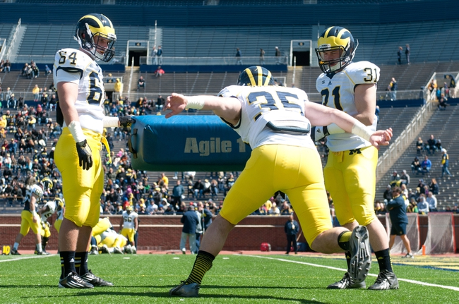 Apr 5, 2014; Ann Arbor, MI, USA; Michigan Wolverines linebackers Michael Wroblewski (64) Joe Bolden (35) and Nick Benda (31) complete drills before the Spring Game at Michigan Stadium. Mandatory Credit: Tim Fuller-USA TODAY Sports
