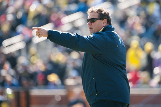 Apr 5, 2014; Ann Arbor, MI, USA; Michigan Wolverines head coach Brady Hoke points during the Spring Game at Michigan Stadium. Mandatory Credit: Tim Fuller-USA TODAY Sports