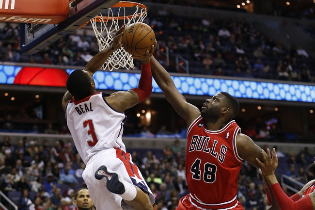 Apr 5, 2014; Washington, DC, USA; Chicago Bulls center Nazr Mohammed (48) blocks the shot of Washington Wizards guard Bradley Beal (3) in the second quarter at Verizon Center. Mandatory Credit: Geoff Burke-USA TODAY Sports