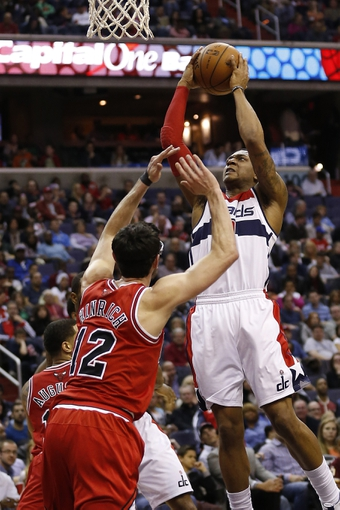 Apr 5, 2014; Washington, DC, USA; Washington Wizards guard Bradley Beal (3) shoots the ball over Chicago Bulls guard Kirk Hinrich (12) in the second quarter at Verizon Center. Mandatory Credit: Geoff Burke-USA TODAY Sports