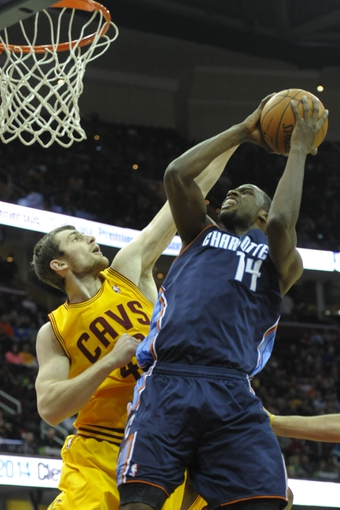Apr 5, 2014; Cleveland, OH, USA; Charlotte Bobcats forward Michael Kidd-Gilchrist (14) shoots against Cleveland Cavaliers center Tyler Zeller (40) in the first quarter at Quicken Loans Arena. Mandatory Credit: David Richard-USA TODAY Sports