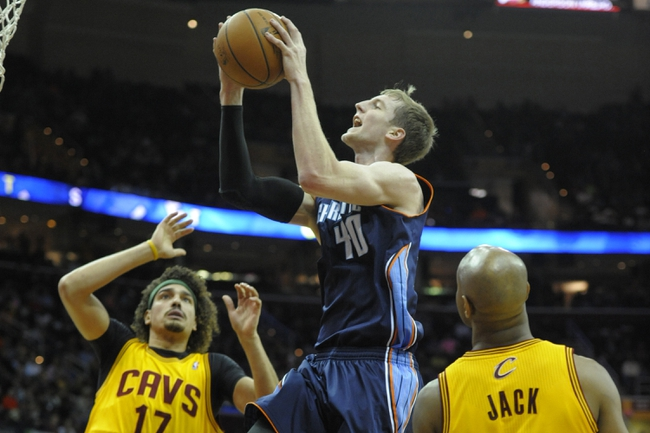 Apr 5, 2014; Cleveland, OH, USA; Charlotte Bobcats center Cody Zeller (40) drives between Cleveland Cavaliers center Anderson Varejao (17) and guard Jarrett Jack (1) in the first quarter at Quicken Loans Arena. Mandatory Credit: David Richard-USA TODAY Sports