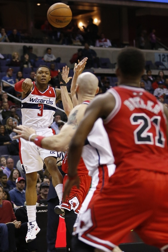 Apr 5, 2014; Washington, DC, USA; Washington Wizards guard Bradley Beal (3) passes the ball to Wizards center Marcin Gortat (4) in front of Chicago Bulls guard Jimmy Butler (21) in the second quarter at Verizon Center. Mandatory Credit: Geoff Burke-USA TODAY Sports