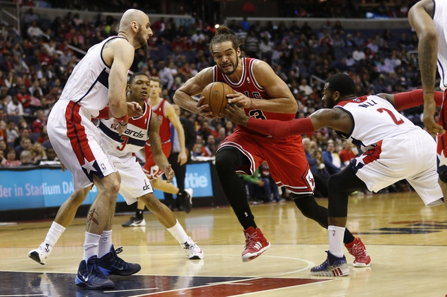 Apr 5, 2014; Washington, DC, USA; Chicago Bulls center Joakim Noah (13) dribbles the ball as Washington Wizards center Marcin Gortat (4) and Wizards guard John Wall (2) defend in the fourth quarter at Verizon Center. The Bulls won 96-78. Mandatory Credit: Geoff Burke-USA TODAY Sports