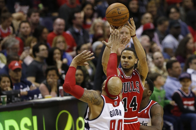 Apr 5, 2014; Washington, DC, USA; Chicago Bulls guard D.J. Augustin (14) shoots the ball over Washington Wizards forward Drew Gooden (90) in the third quarter at Verizon Center. The Bulls won 96-78. Mandatory Credit: Geoff Burke-USA TODAY Sports