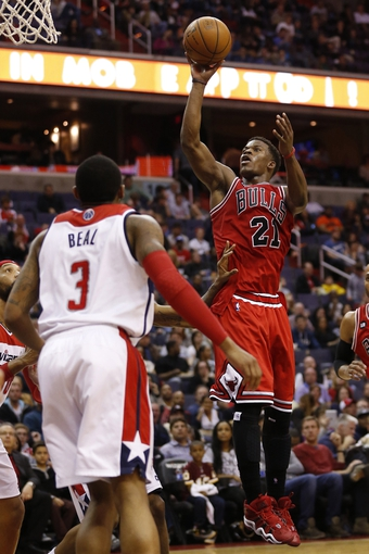 Apr 5, 2014; Washington, DC, USA; Chicago Bulls guard Jimmy Butler (21) shoots the ball over Washington Wizards guard Bradley Beal (3) in the fourth quarter at Verizon Center. The Bulls won 96-78. Mandatory Credit: Geoff Burke-USA TODAY Sports