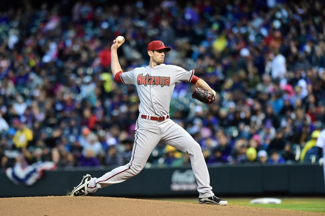Apr 5, 2014; Denver, CO, USA; Arizona Diamondbacks starting pitcher Brandon McCarthy (32) pitches against the Colorado Rockies in the first inning at Coors Field. Mandatory Credit: Ron Chenoy-USA TODAY Sports
