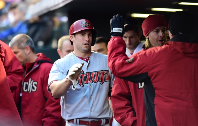 Apr 5, 2014; Denver, CO, USA; Arizona Diamondbacks first baseman Paul Goldschmidt (44) is congratulated after scoring against the Colorado Rockies in the first second inning at Coors Field. Mandatory Credit: Ron Chenoy-USA TODAY Sports