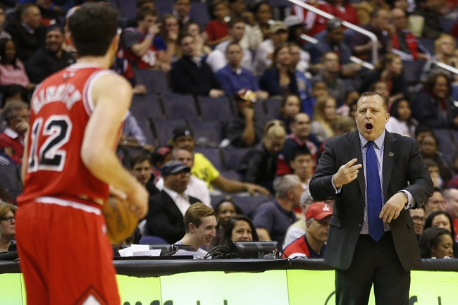 Apr 5, 2014; Washington, DC, USA; Chicago Bulls head coach Tom Thibodeau (R) gestures to Chicago Bulls guard Kirk Hinrich (12) against the Washington Wizards in the second quarter at Verizon Center. The Bulls won 96-78. Mandatory Credit: Geoff Burke-USA TODAY Sports