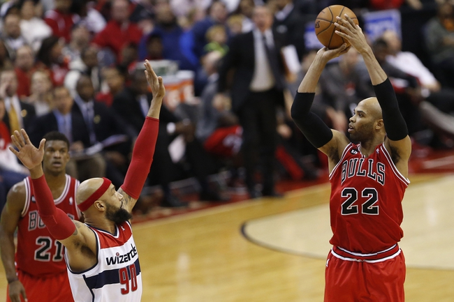 Apr 5, 2014; Washington, DC, USA; Chicago Bulls forward Taj Gibson (22) shoots the ball over Washington Wizards forward Drew Gooden (90) in the third quarter at Verizon Center. The Bulls won 96-78. Mandatory Credit: Geoff Burke-USA TODAY Sports