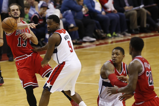 Apr 5, 2014; Washington, DC, USA; Chicago Bulls center Joakim Noah (13) passes the ball to Bulls guard Jimmy Butler (21) as Washington Wizards forward Martell Webster (9) and Wizards guard Bradley Beal (3) defend in the third quarter at Verizon Center. The Bulls won 96-78. Mandatory Credit: Geoff Burke-USA TODAY Sports