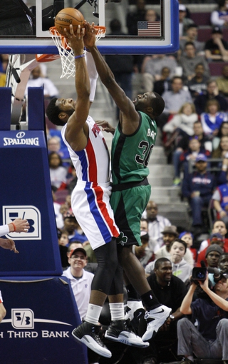 Apr 5, 2014; Auburn Hills, MI, USA; Detroit Pistons center Andre Drummond (0) and Boston Celtics forward Brandon Bass (30) fight for a rebound during the fourth quarter at The Palace of Auburn Hills. Pistons beat the Celtics 115-111. Mandatory Credit: Raj Mehta-USA TODAY Sports